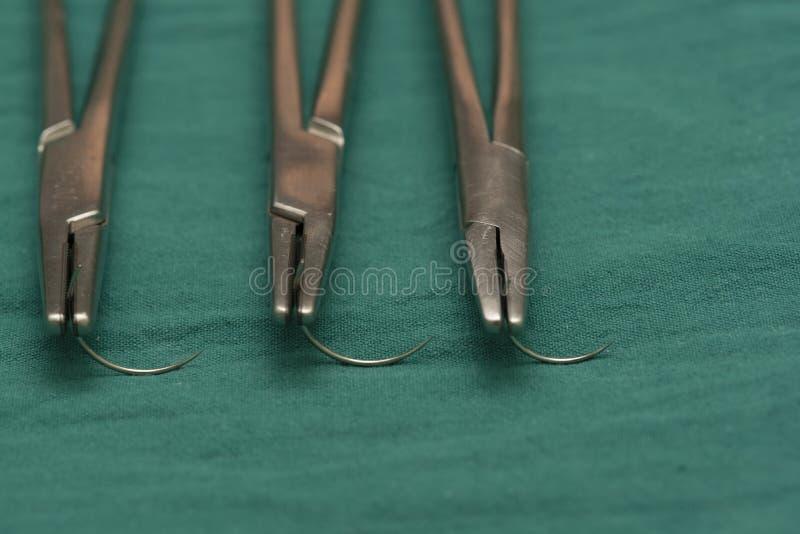 Drie naaldhouders en lege naalden stock foto