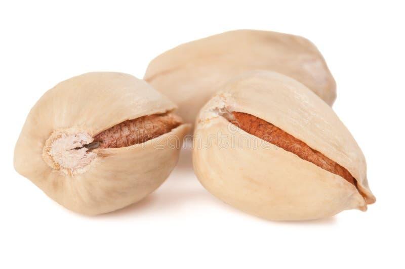 Drie natuurlijke pistaches stock afbeelding