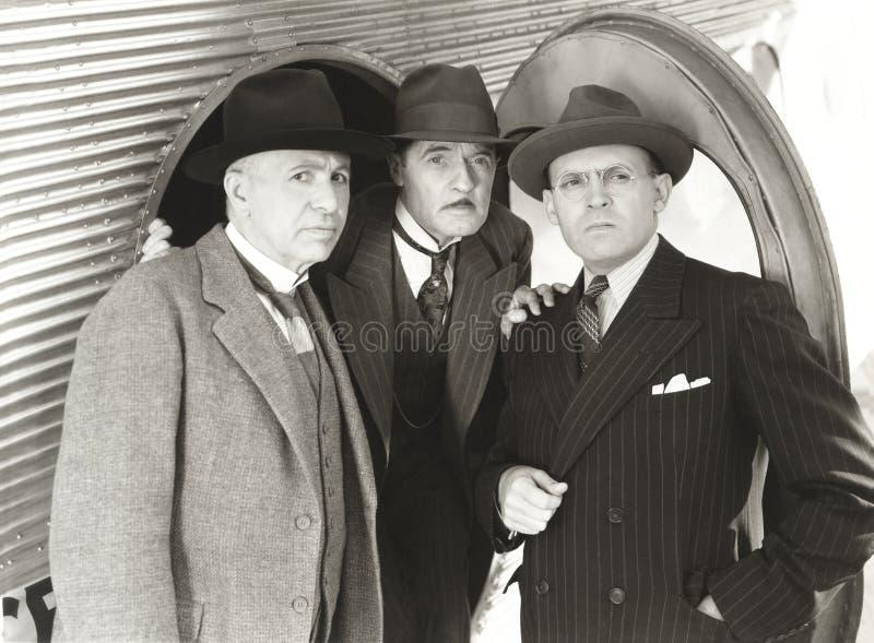 Drie nieuwsgierige mensen royalty-vrije stock foto