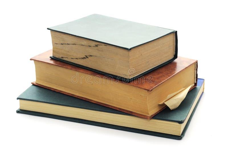 Drie oude uitstekende boeken op wit. royalty-vrije stock foto