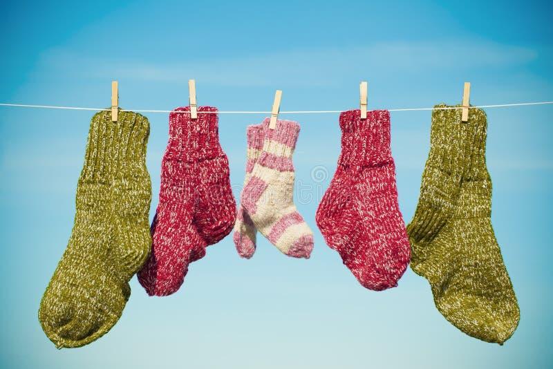 Drie paren wollen sokken stock foto's