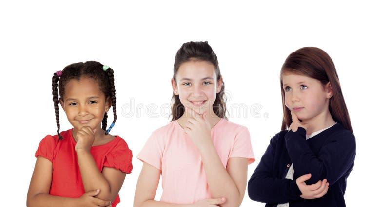 Drie peinzende kinderen royalty-vrije stock afbeeldingen