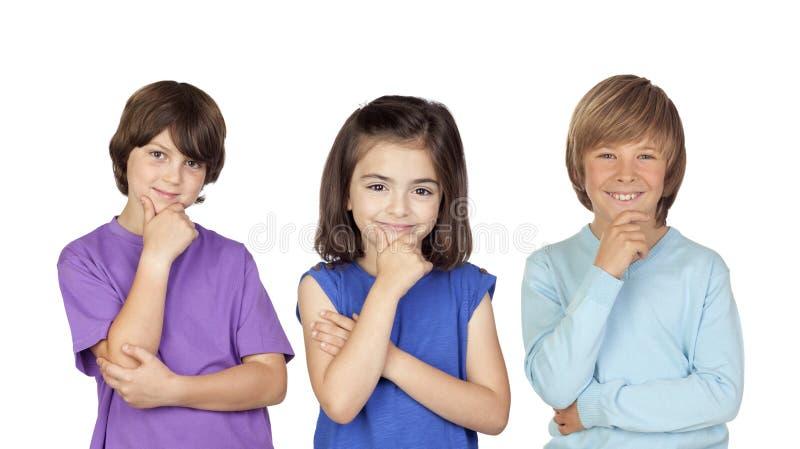 Drie peinzende kinderen royalty-vrije stock fotografie