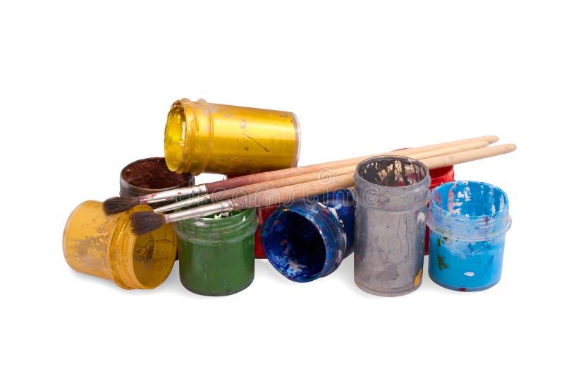 Drie penselen Gouachekleur in containers royalty-vrije stock afbeeldingen