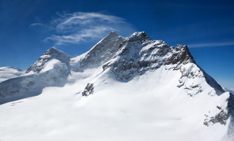 Drie pieken in Zwitserse Alpen: Monch, Jungrau, Eiger royalty-vrije stock foto
