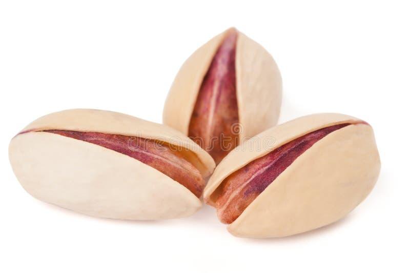 Drie pistaches op wit royalty-vrije stock foto
