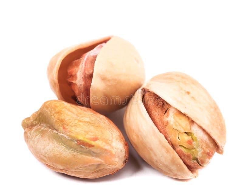Drie pistaches sluiten omhoog. royalty-vrije stock afbeeldingen