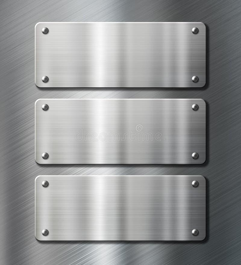 Drie platen van het roestvrij staalmetaal op geborsteld royalty-vrije stock afbeeldingen