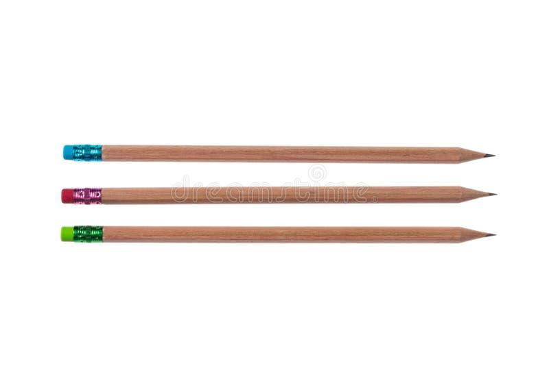 Drie potloden met roze, groene en blauwe die gommen op witte achtergrond, hoogste mening worden geïsoleerd stock afbeeldingen