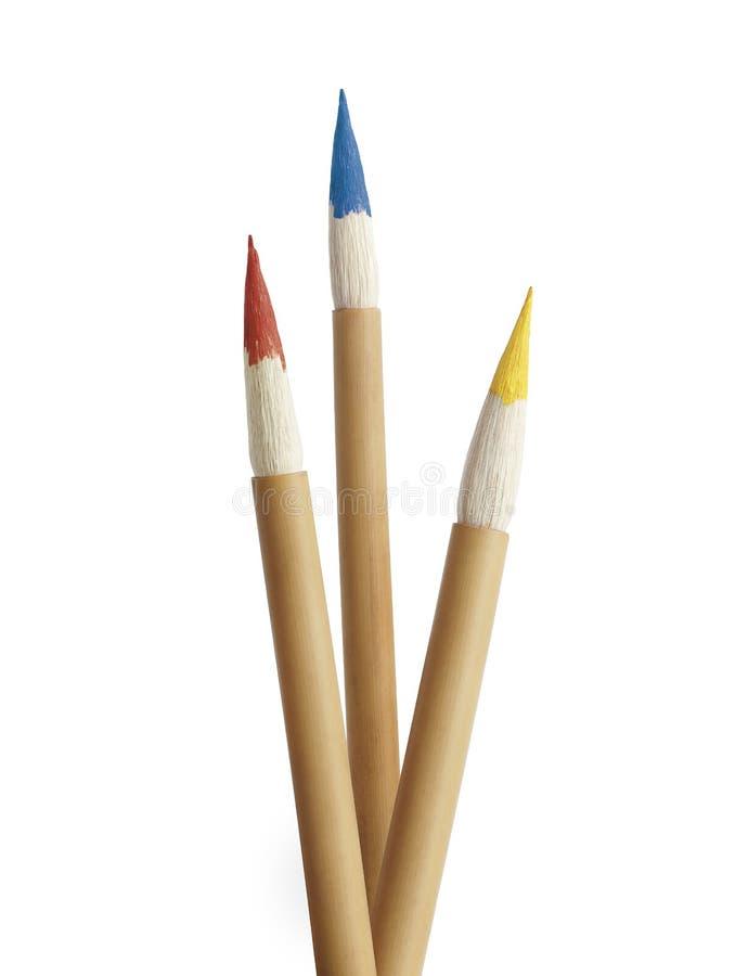 Drie primaire borstels van de kleurenverf stock afbeeldingen