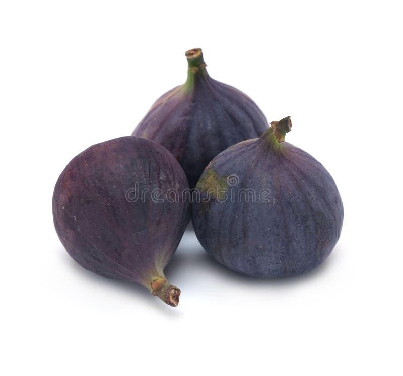 Drie rijpe die fig.vruchten op witte close-up worden geïsoleerd royalty-vrije stock foto