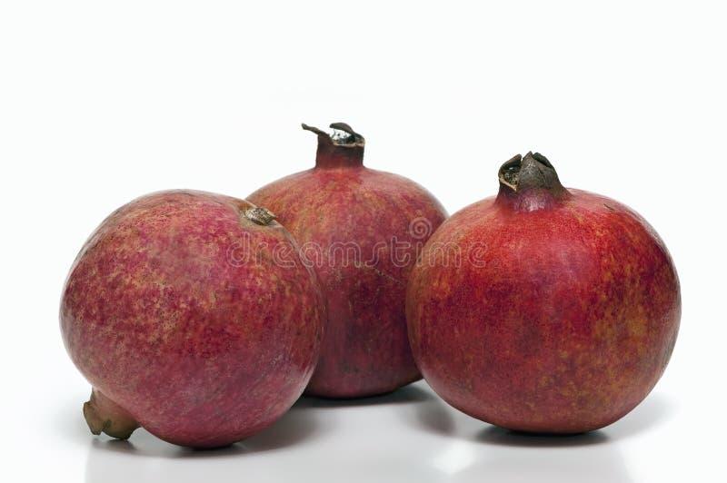 Drie rijpe granaatappels royalty-vrije stock fotografie