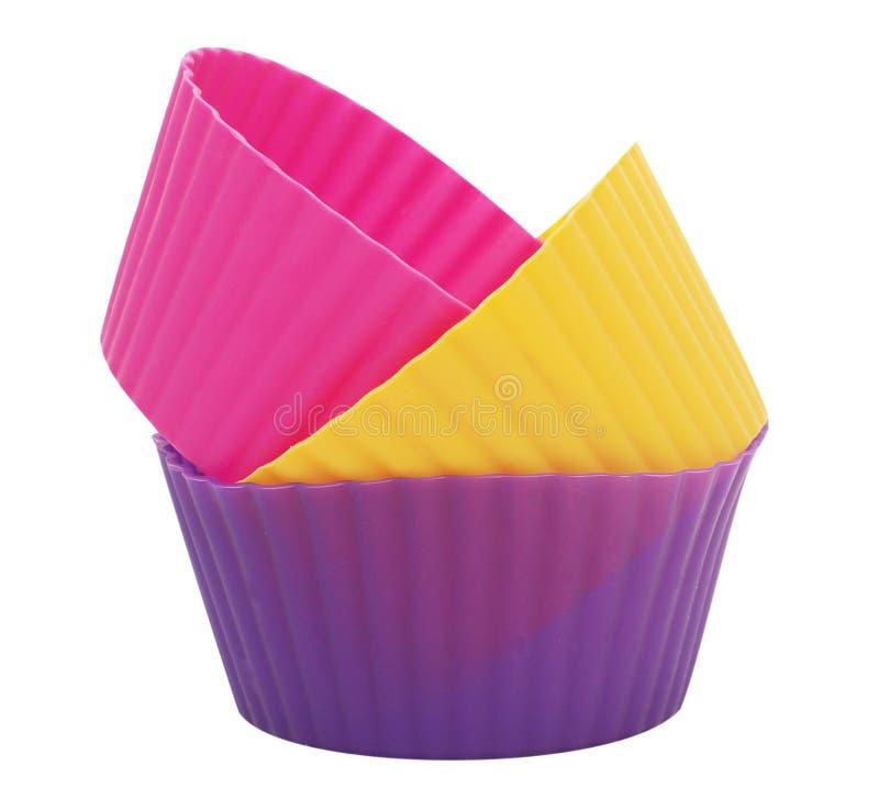 Drie siliconevormen voor cake stock afbeelding