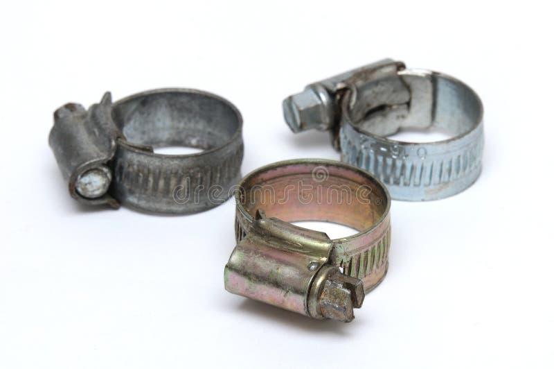 Drie slangklemmen van het verschillende type van oppervlakteplateren royalty-vrije stock afbeelding
