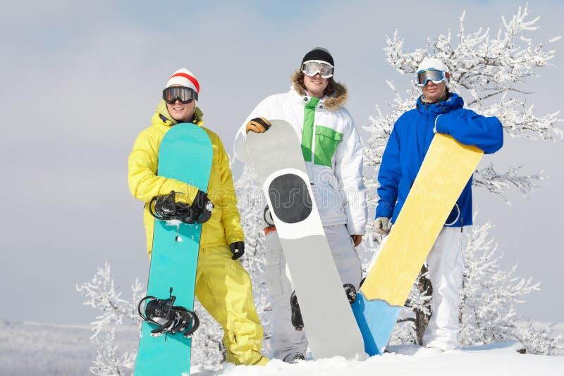 Drie snowboarders royalty-vrije stock afbeeldingen
