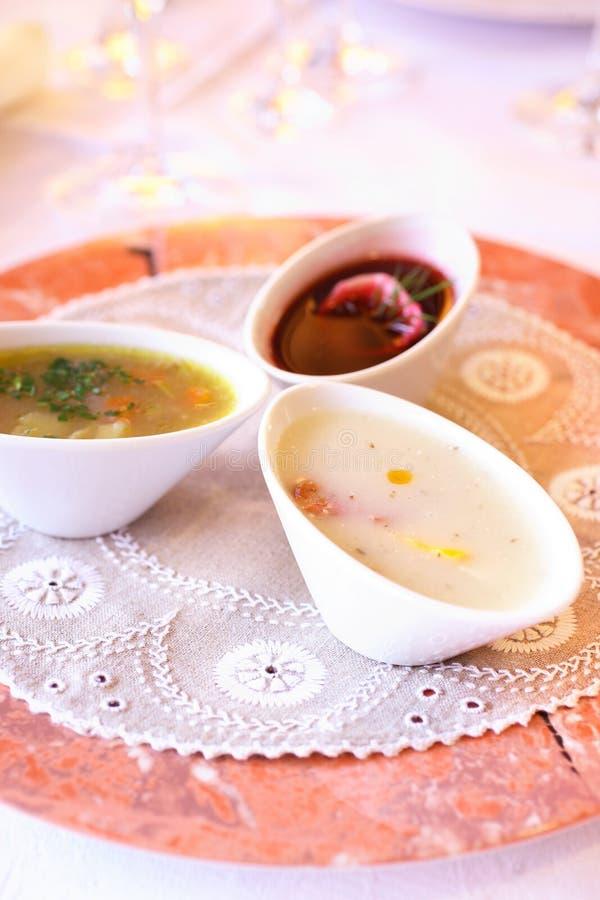 Drie soepen in kommen stock afbeelding