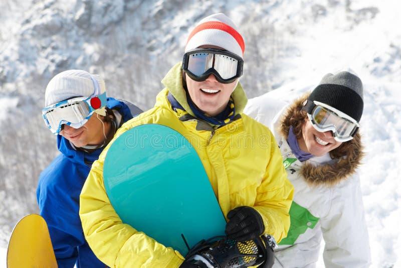 Drie sportieve mensen stock afbeelding