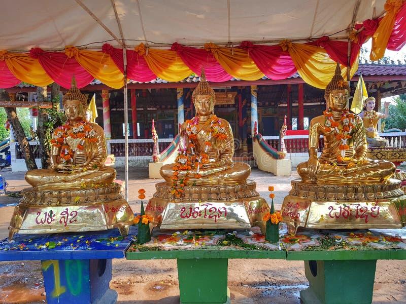 Drie standbeelden van Boedha stock afbeeldingen