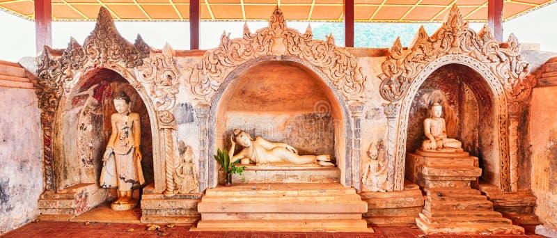 Drie standbeelden van Boedha in Takhaung Mwetaw Paya in Sankar stock foto