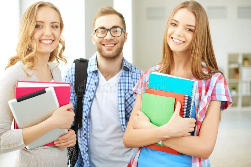 Drie studenten royalty-vrije stock afbeelding