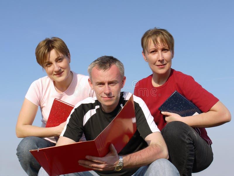 Drie studenten stock afbeeldingen