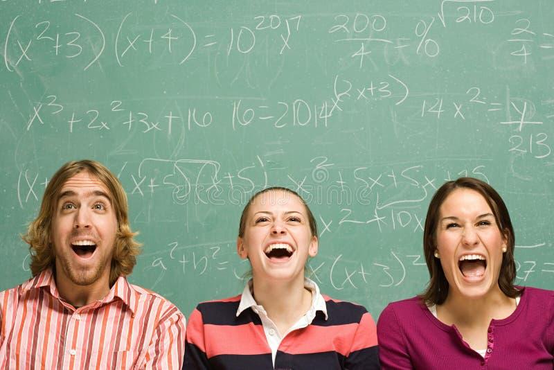 Drie studenten het lachen royalty-vrije stock fotografie