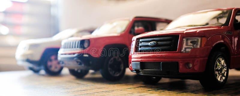 Drie stuk speelgoed auto's stock fotografie