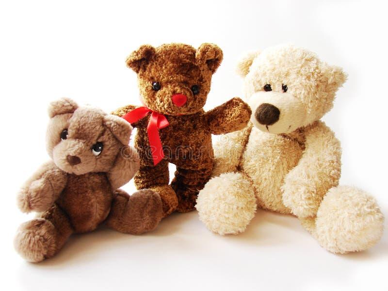 Drie teddy-beren stock afbeelding