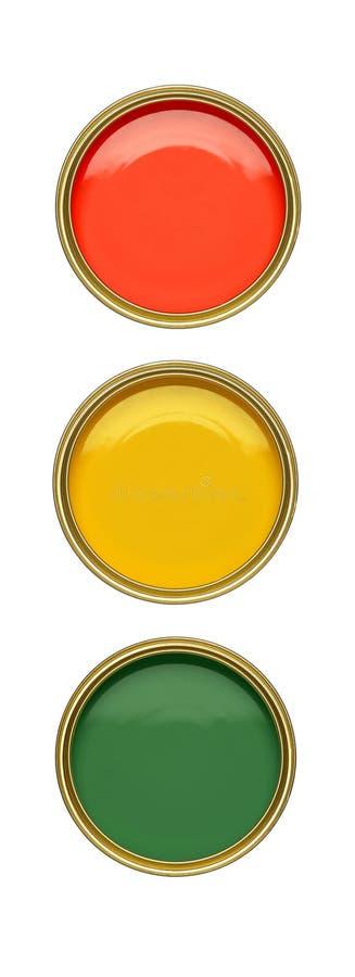 drie tinblikken van rode amber en groene verf stock foto's