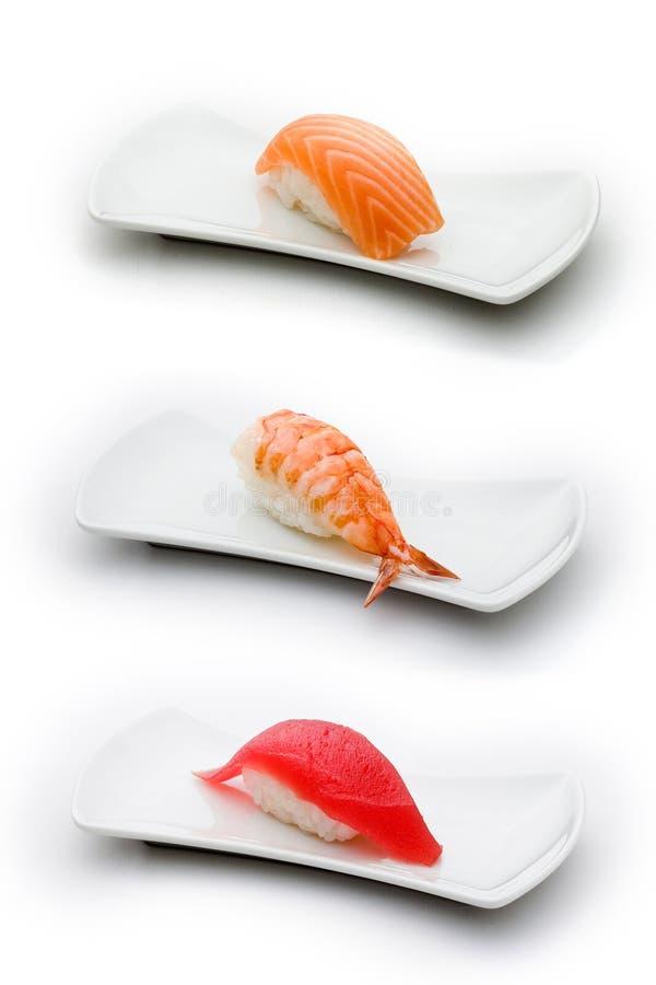 Drie types van sushi: zalm, garnalen en tonijn stock afbeeldingen