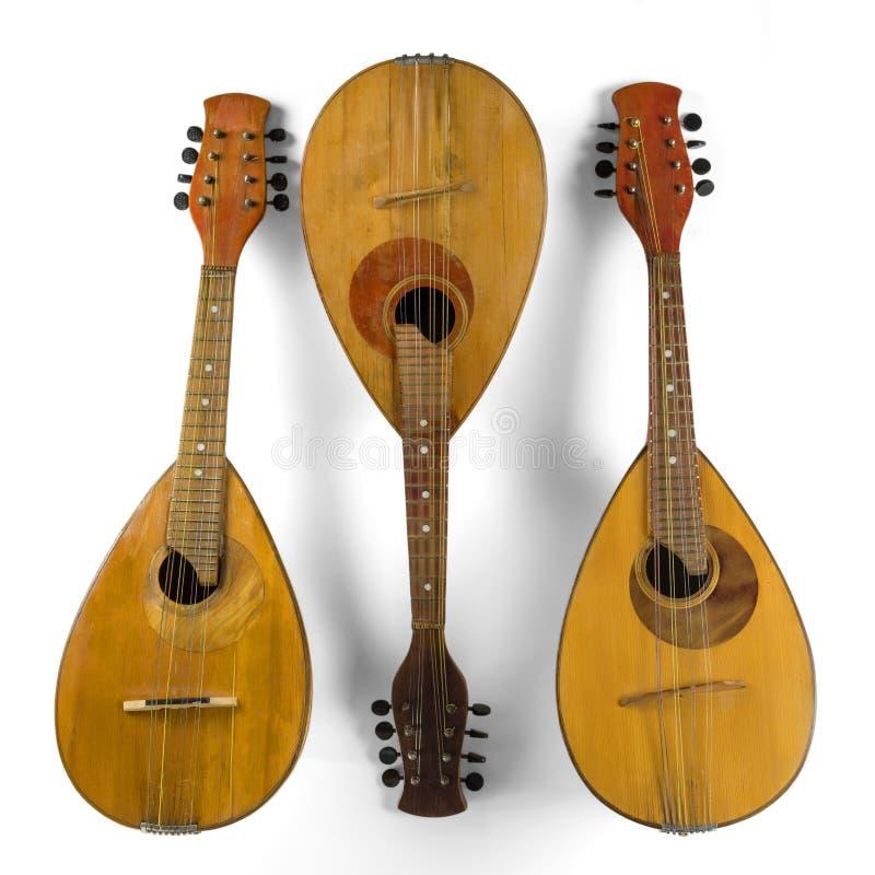 Drie uitstekende mandolines Ge?soleerd op een witte achtergrond royalty-vrije stock foto's