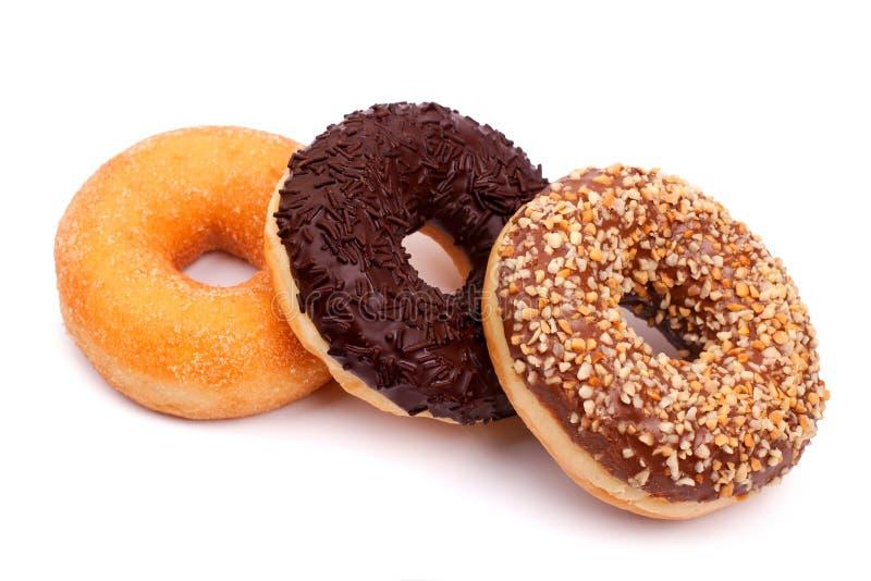 Drie verschillende donuts op witte achtergrond royalty-vrije stock foto