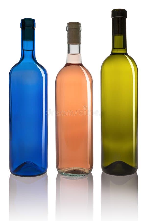 Drie verschillende gekleurde flessen royalty-vrije stock foto