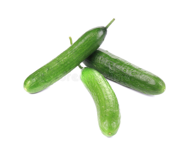 Drie verse komkommers stock foto