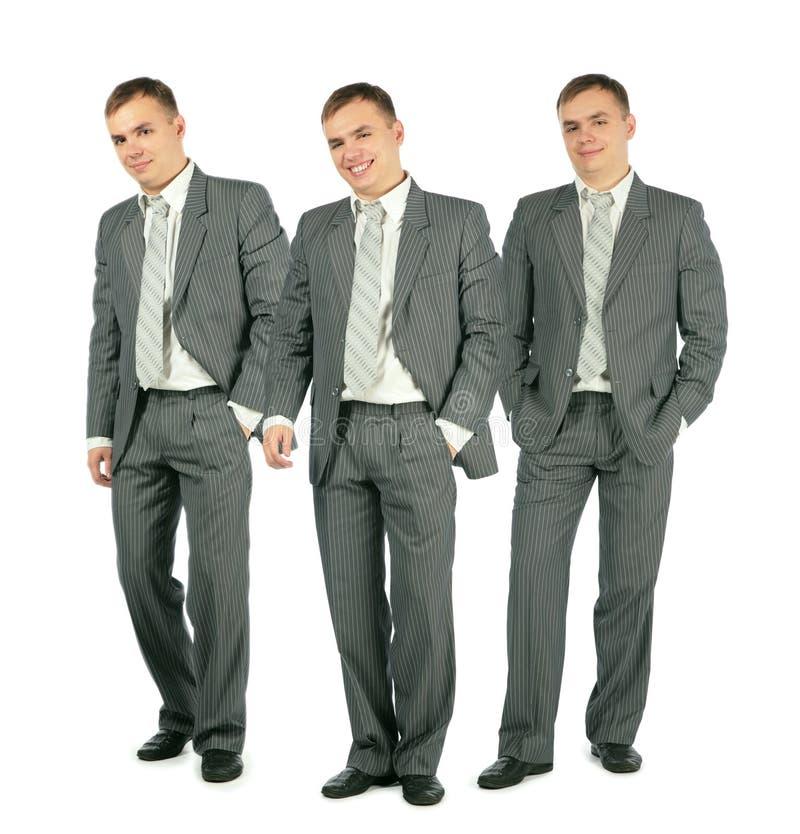 Drie vrolijke zakenlieden die zich op wit, collage bevinden royalty-vrije stock afbeelding