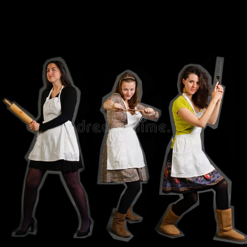 Drie vrouwelijke koks stock foto's