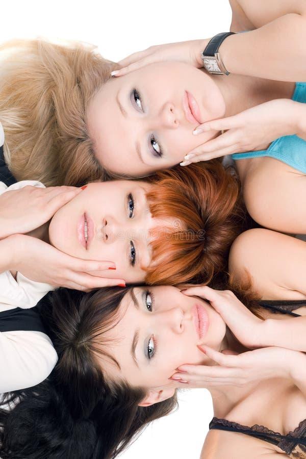 Drie vrouwen stock afbeeldingen