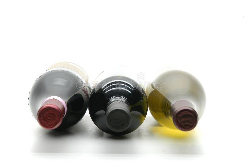 Drie wijnfles stock foto's