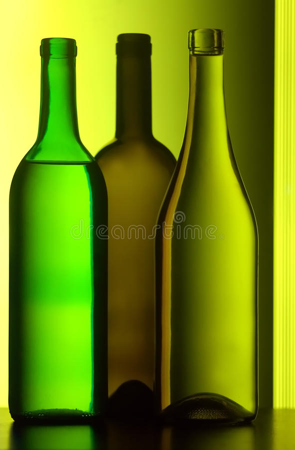 Drie wijnflessen stock foto