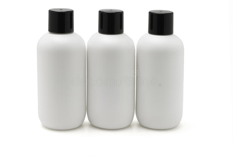 Drie witte plastic flessen royalty-vrije stock fotografie