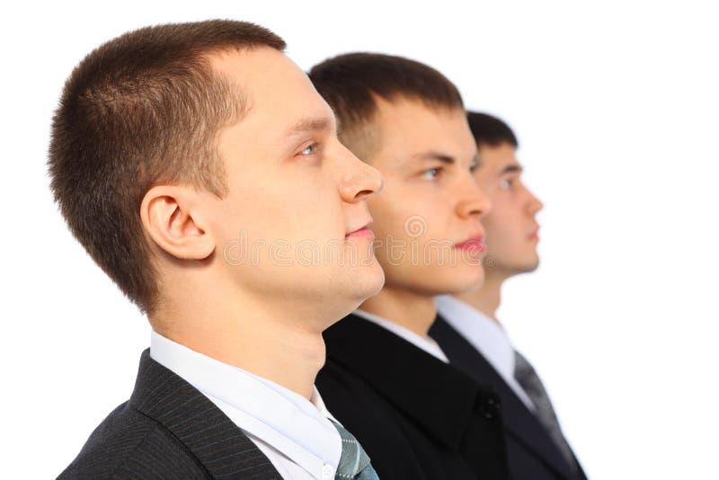 Drie zakenlieden in profiel stock afbeelding