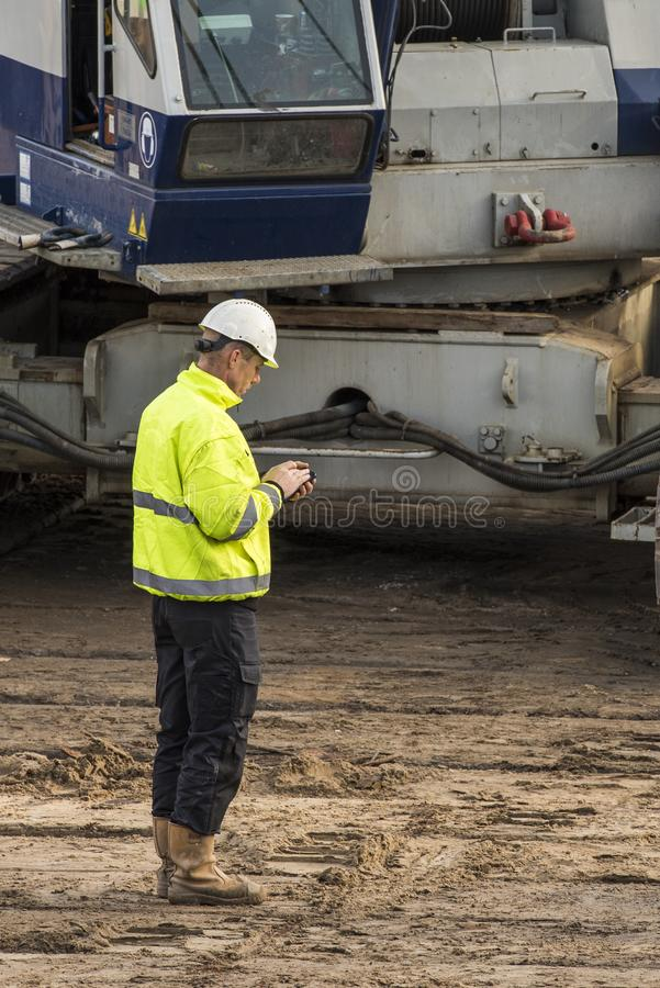 Construction Site Worker Cell Phone Driebergen Station royalty free stock photos