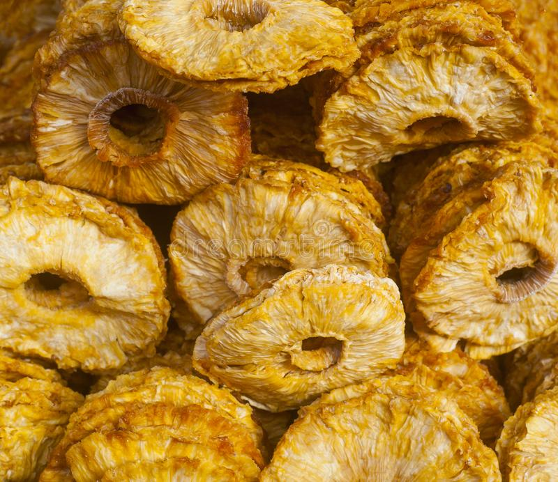 Dried ananas fruits on a pile on a food market, coloful dried fr royalty free stock photo