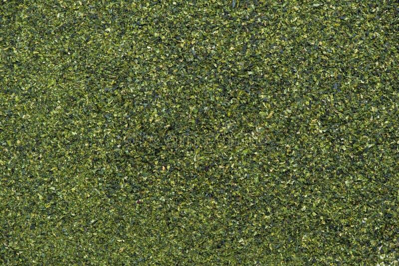 Dried aonori seaweed flakes full frame background royalty free stock photos