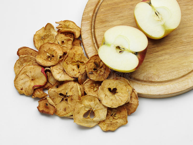 Dried apple. Fresh tasty ripe apple with dried ones royalty free stock photo