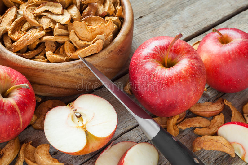 Dried apple slices and fresh apple fruit on table. Dried apple slices and fresh apple fruit on kitchen table stock images