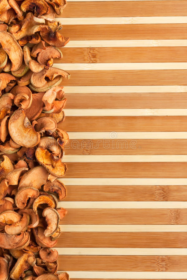 Dried apples on a bamboo mat. With space for text, for menu royalty free stock photos