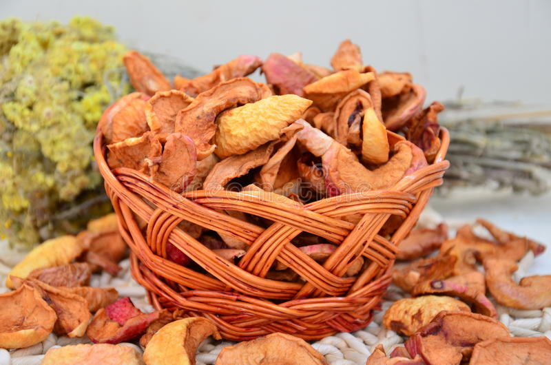 Dried apples in a basket royalty free stock image