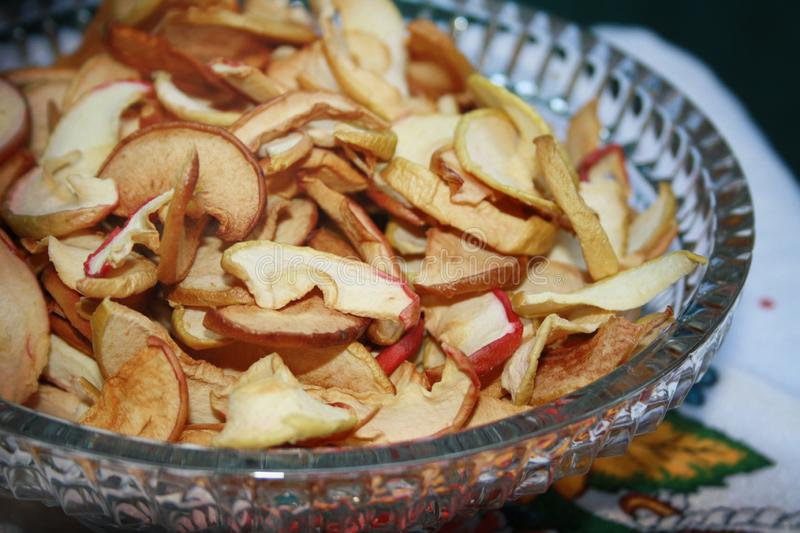 Dried apples in the chrystal vase. Dried apple slices in the chrystal vase royalty free stock photography