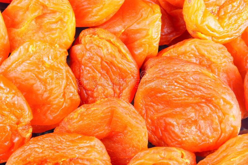 Dried apricots - dried halves of apricot fruit without seeds. Dried apricots are popular in cooking, sweet dried fruit, healthy. Food, compote making stock photo